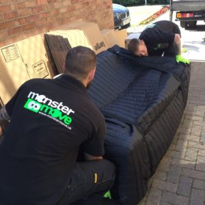 Safe carrying of a sofa during a house removal